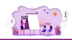 """Representación con líneas de la figura de una mujer de edad media con cabello negro y blusa color lila, se encuentra explicando la palabra """"hola"""" frente a dos niños, una niña con cabello negro, sentada de espaldas en una silla color morada y un niño con cabello negro, sentado de espaldas en una silla color morada."""