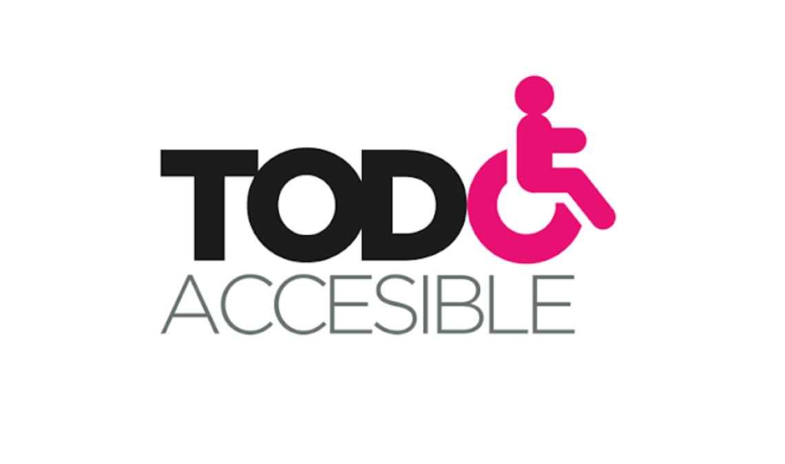"""Imagen con el logotipo de la asociación Todo Accesible compuesto por el texto """"Todo Accesible"""" en color negro, excepto la letra O de la palabra Todo, está sustituida por una representación gráfica en líneas de color rosa de una persona en silla de ruedas."""